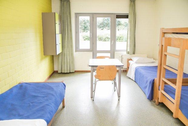 Kamer in de bijgebouwen met eigen sanitair